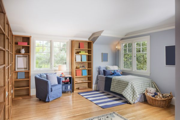 Room for kids and teenagers with wooden shelfs.
